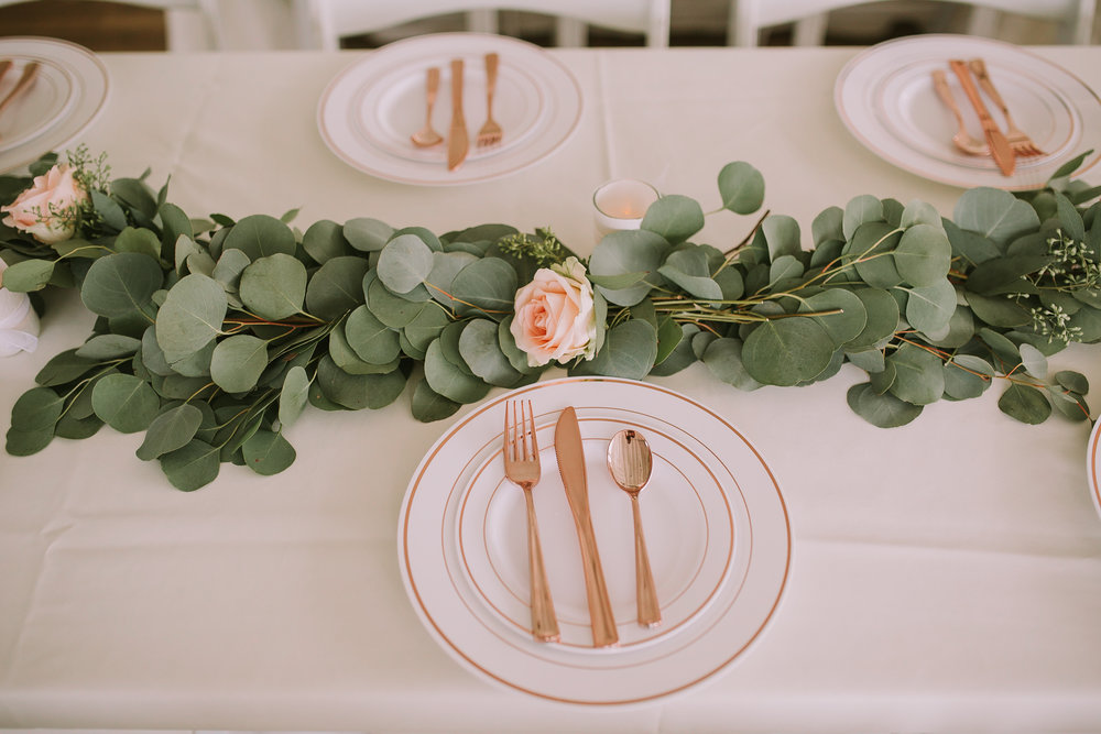 Eucalyptus rose garland + rose gold accent tablescape (Photo by Keoni Kitagawa)