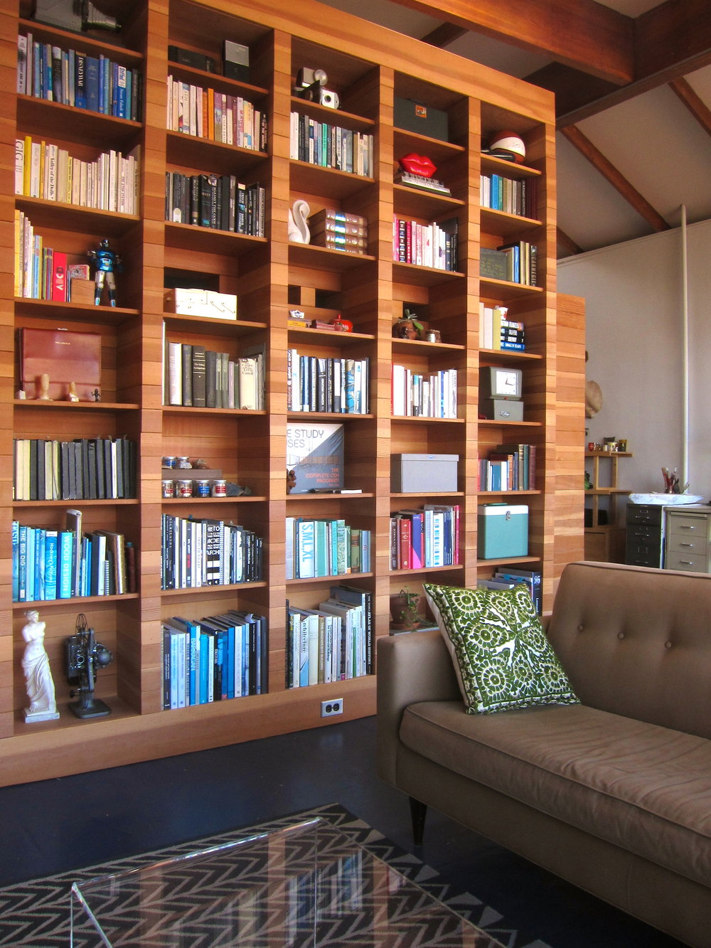 FIR-CLAD BOOKCASE WITH PEEP/VENT HOLES INTO BEDROOM