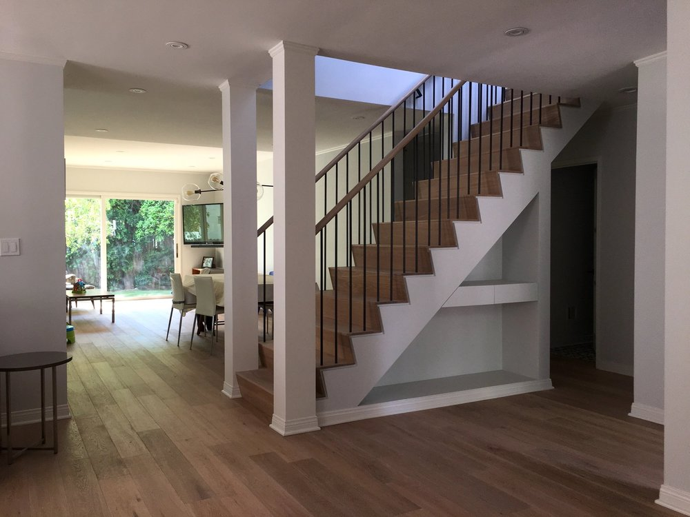 RECONFIGURED STAIR OPENING ONTO DINING & DEN