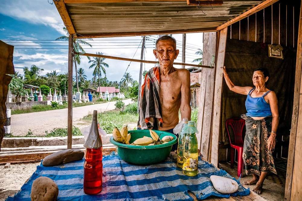 Lao couple in their roadside shop