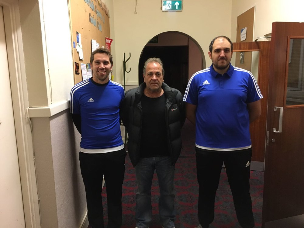 First team co-manager Aaron Fry, chairman Kevin Mitchell and new signing Scott Johnston