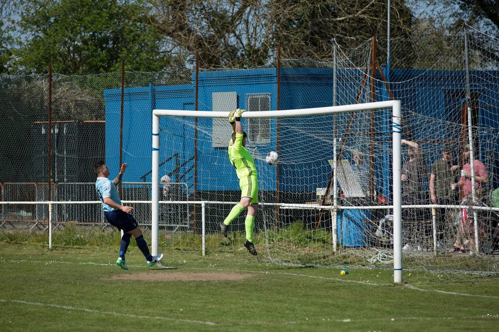 Brockenhurst goalkeeper watches the ball head over the cross bar