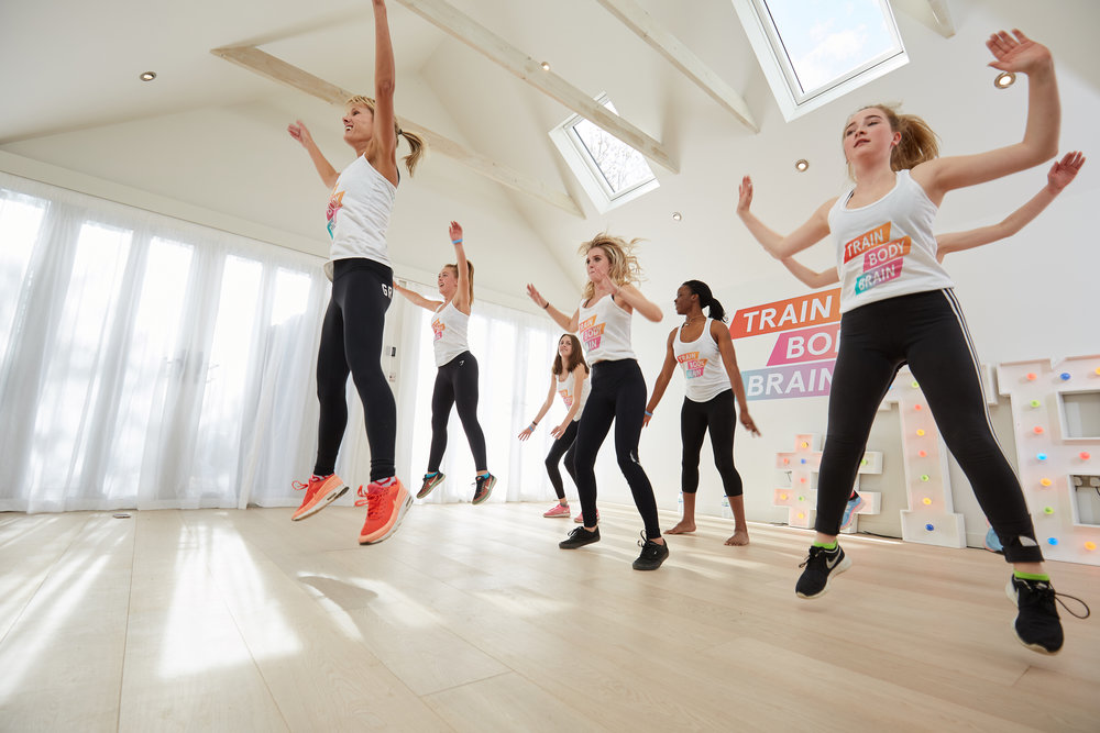 Jumping in teen fitness class