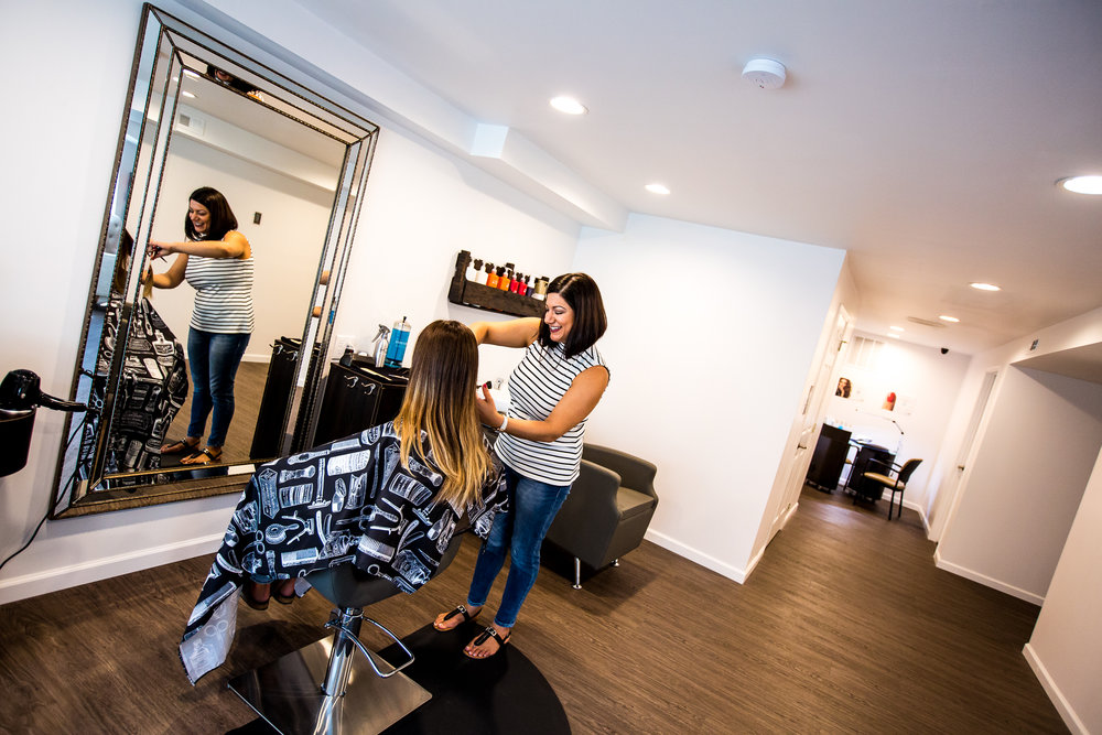 Owner Nesma Karedis giving one of her clients a fresh cut and color.