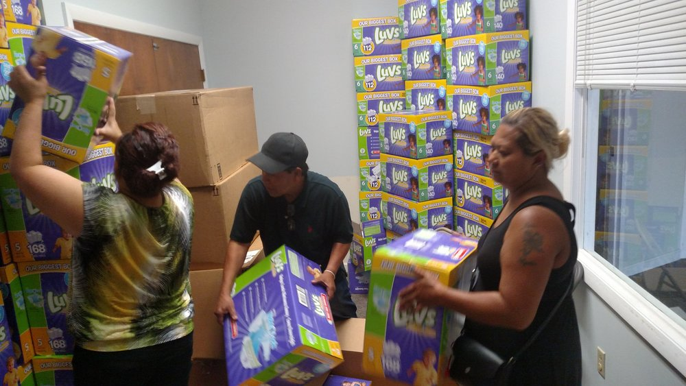 Volunteers help restock the Diaper Bank.