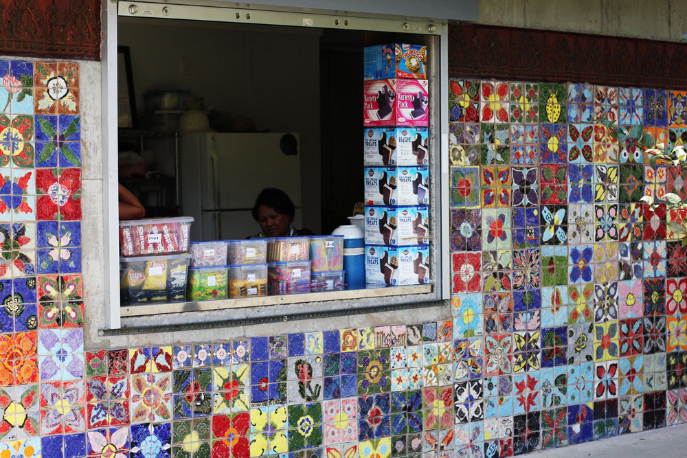 Local Khmer food concession in Clemente Park. Tiles created by students at the Pyne Arts Magnet School.