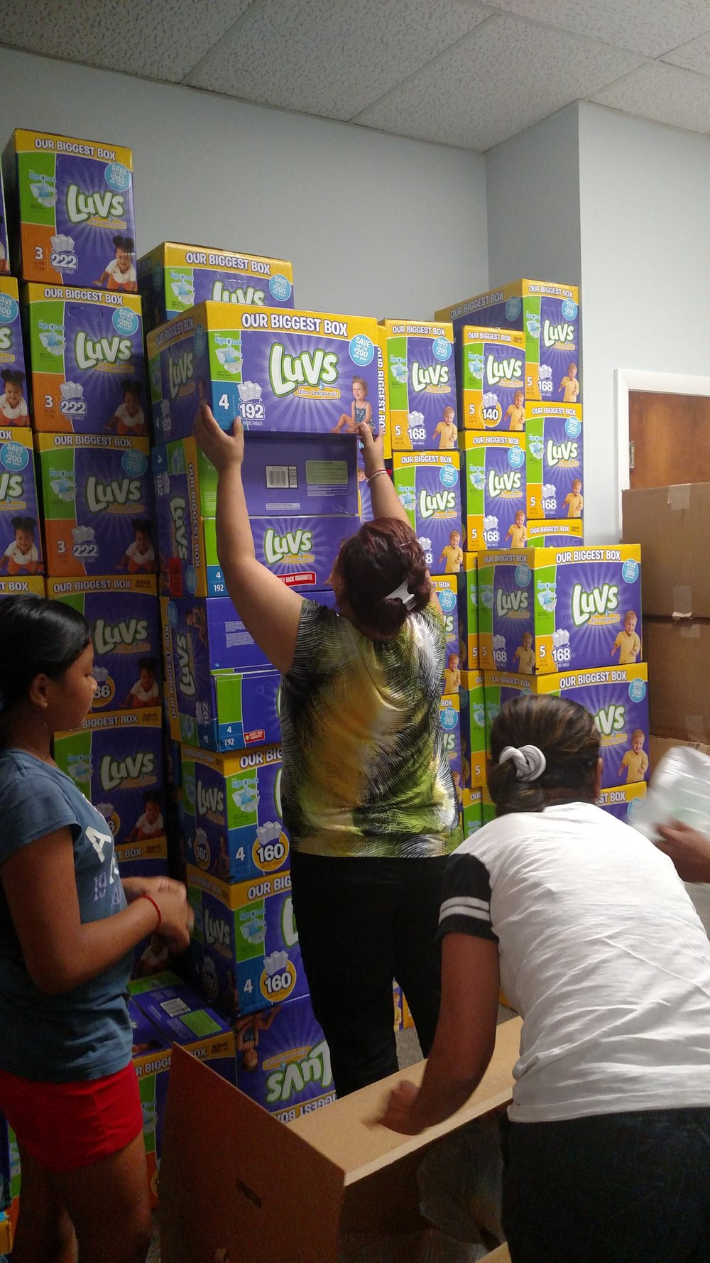 Volunteers restock the Diaper Bank