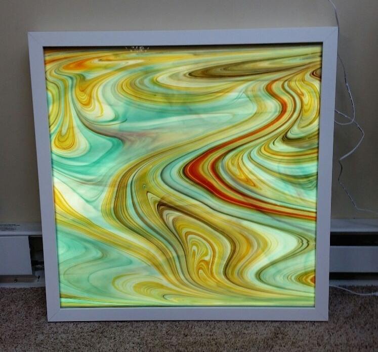 Finished glass tile lit.
