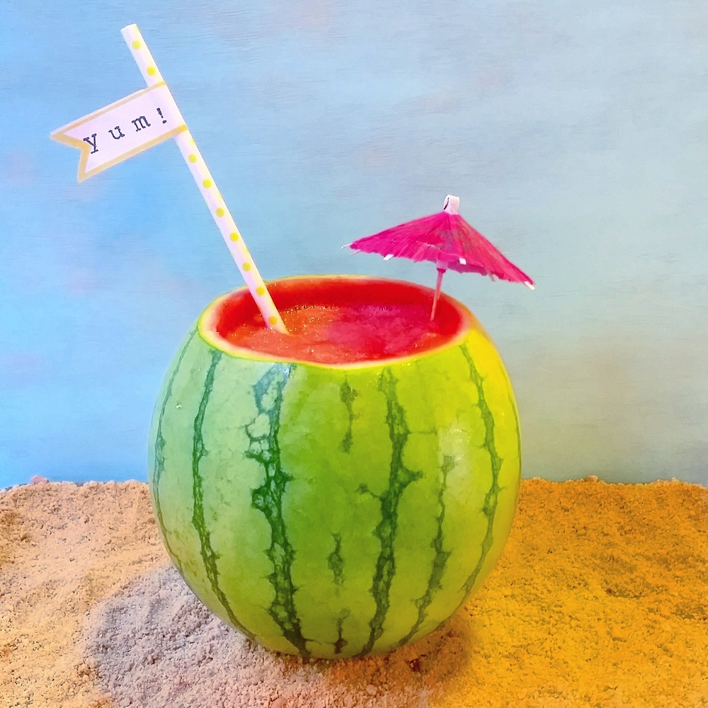 This refreshing treat didn't last long in our house. Sweet, tart and delicious! We picture sitting beach side with one of these. Maybe add a little tequila for a fun adult twist   What You Need:   Mini Watermelon (You will use 3 cups of the insides)  1/2 cup orange juice  1/4 cup lemon juice  1/4 cup lime juice  1-2 cups of ice depending on texture preference  1/2 cup simple syrup   How To Make:   Cut top off of watermelon making sure bottom can sit on its own.  Scoop out the watermelon and put 3 cups in a bowl.  Freeze the watermelon that was scooped out for about 2 hours.  In a blender combine watermelon, oj, lemon and lime juice.  Add simple syrup in small amounts and sweeten to your taste.  Add in ice and blend.