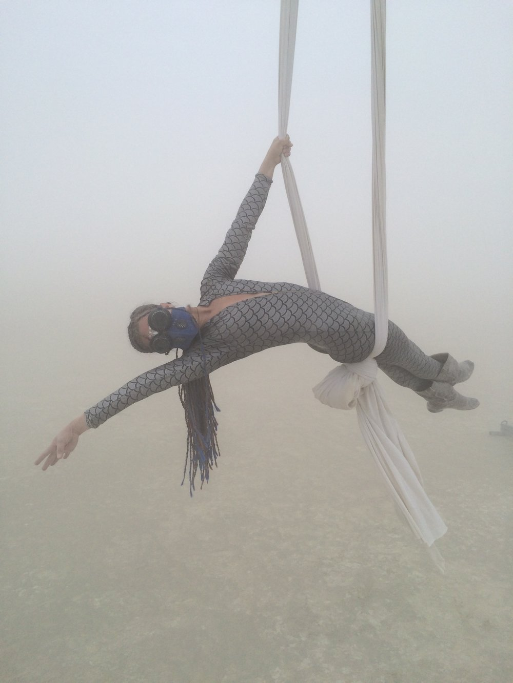 Sarah plays on the silks in the dust storm.