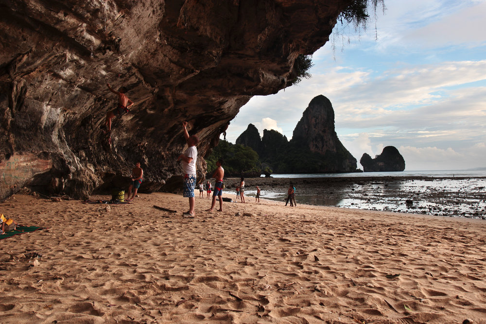 Rock Climbers in the cave at Tonsai Beach at low tide.