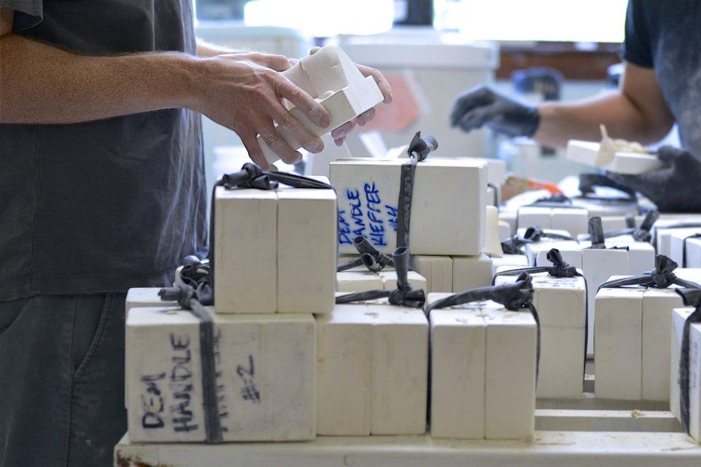 Evan Cornish Keefe pulling mug handles from molds.