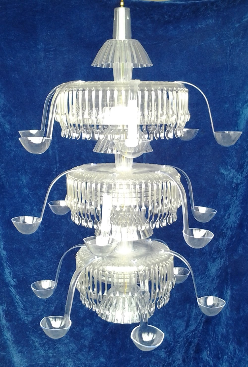 Eating Light - Chandelier made from dollar-store fake crystal tableware. Concept, design, fabrication, and installation.