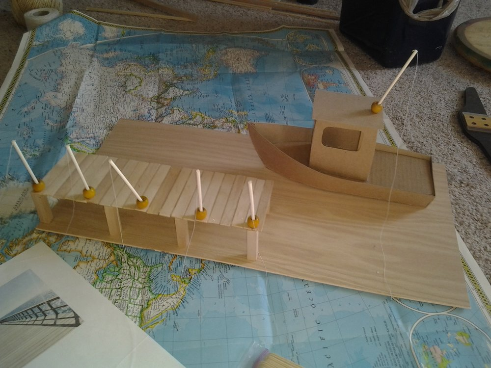 Final Voyage - Memorial commission, scale-model fishing boat and pier (incomplete as shown). Concept, design, fabrication.
