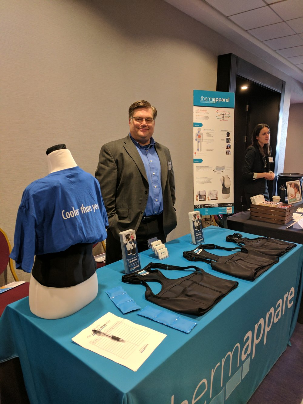 Kurtis at ThermApparel's table at the Rochester Venture Challenge