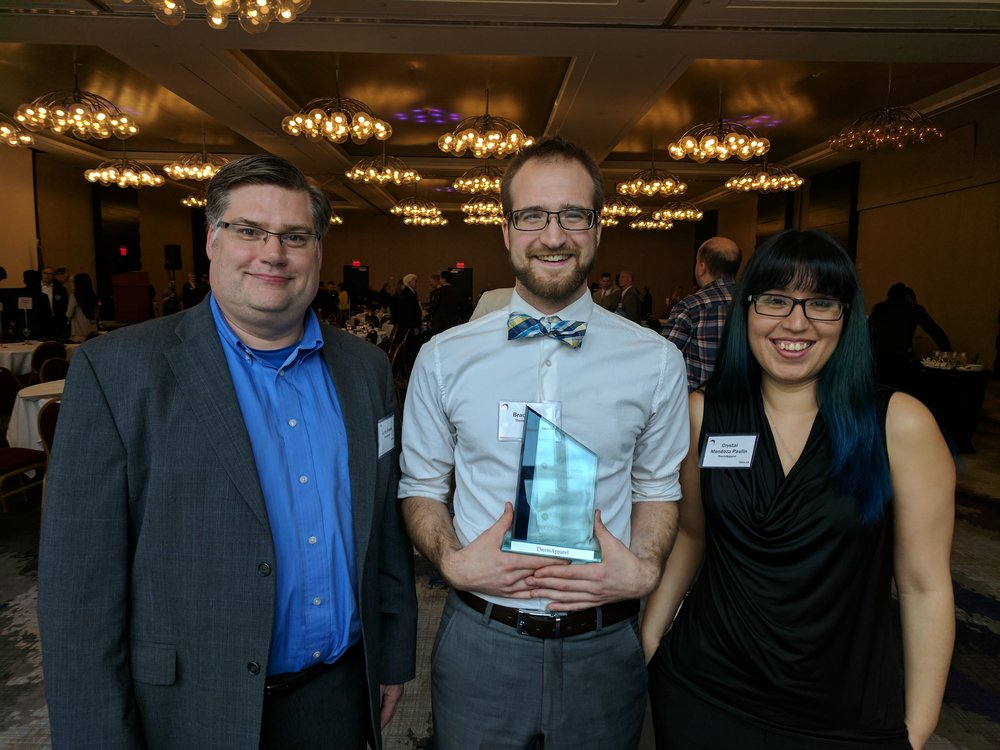 ThermApparel poses with 2nd place award at the Rochester Venture Challenge.