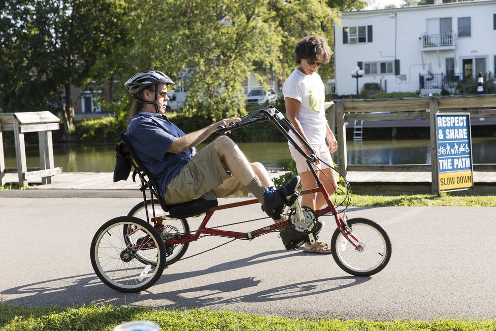 Man rides adaptive trike with Rochester Accessible Adventures.