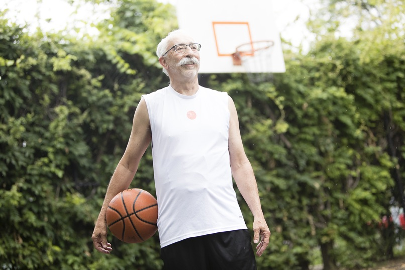 Gentleman plays basketball with UnderCool cooling vest under his jersey.