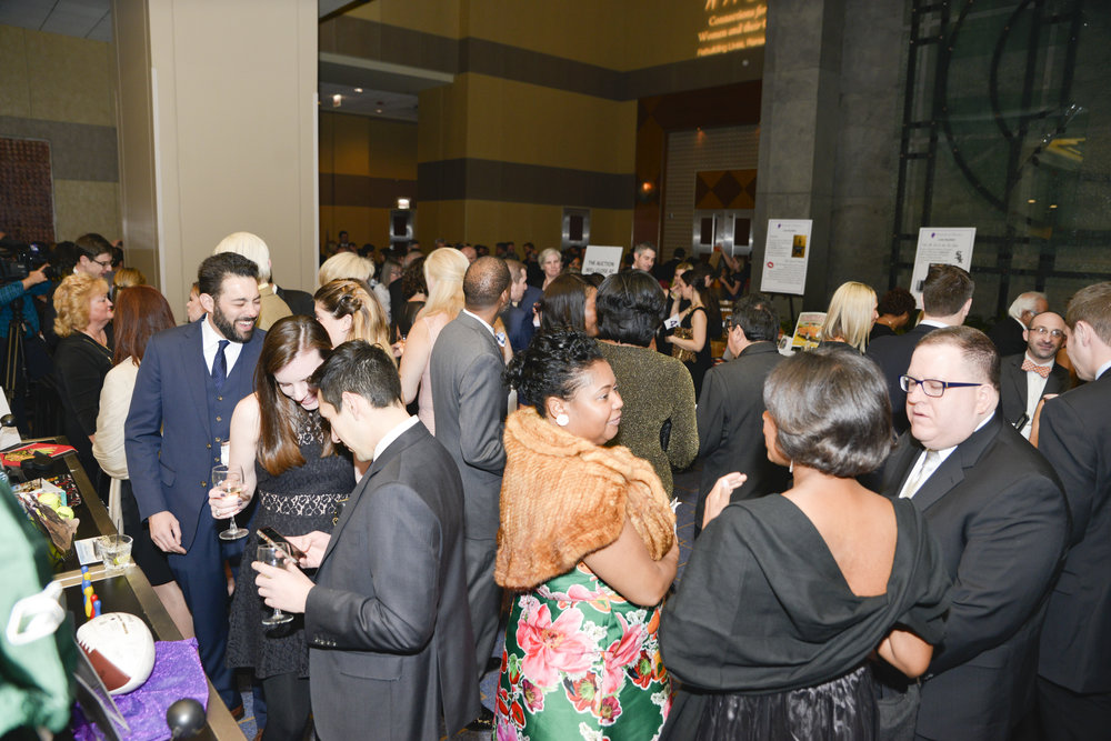 Some of the Gala's 418 guests socializing and placing their bids for the evening's silent auction.