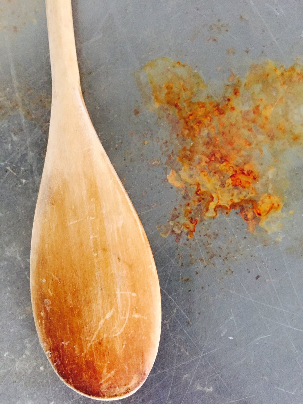 An ordinary wooden spoon becomes a beautiful part of an abstract composition.  Rust and scratches never looked so good!