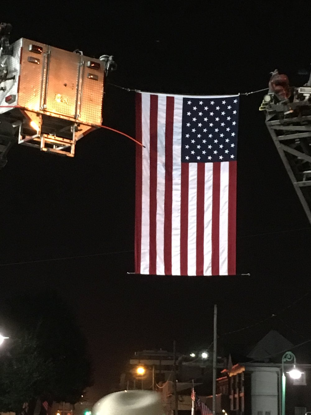 flag between fire trucks after concert.jpg