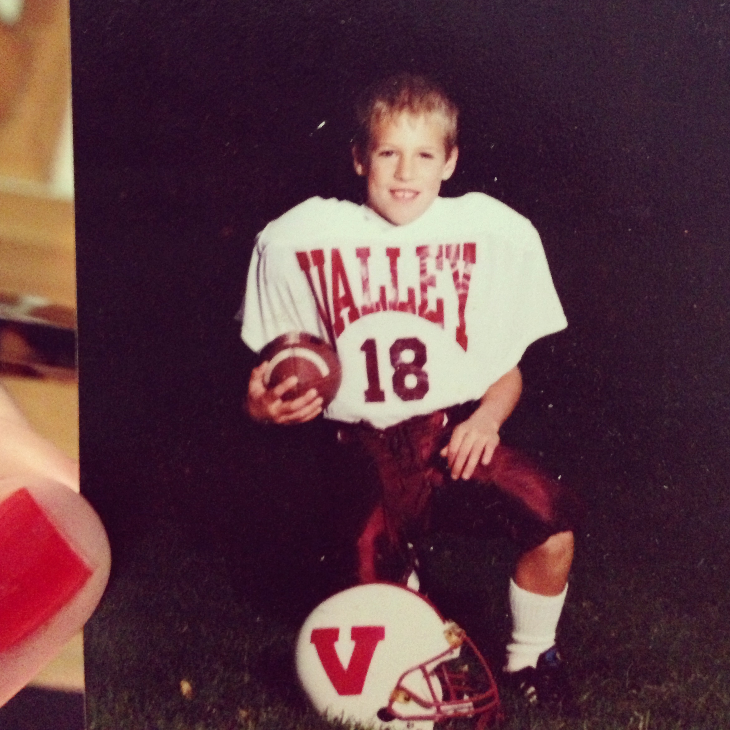 young Patrick playing football