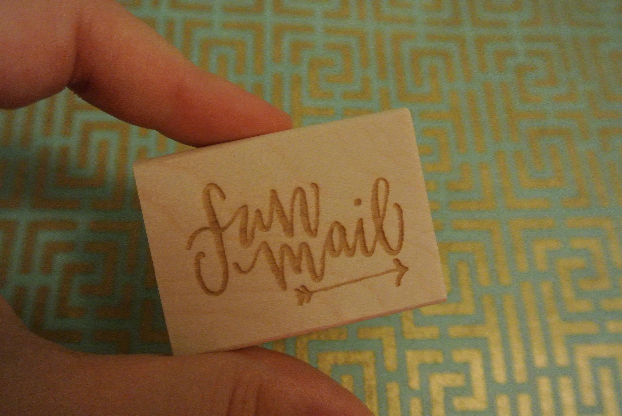 holding fun mail stamp