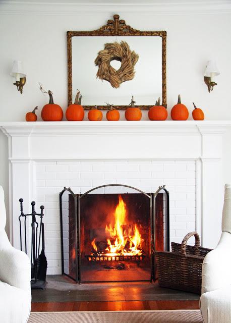 pumpkins around fireplace