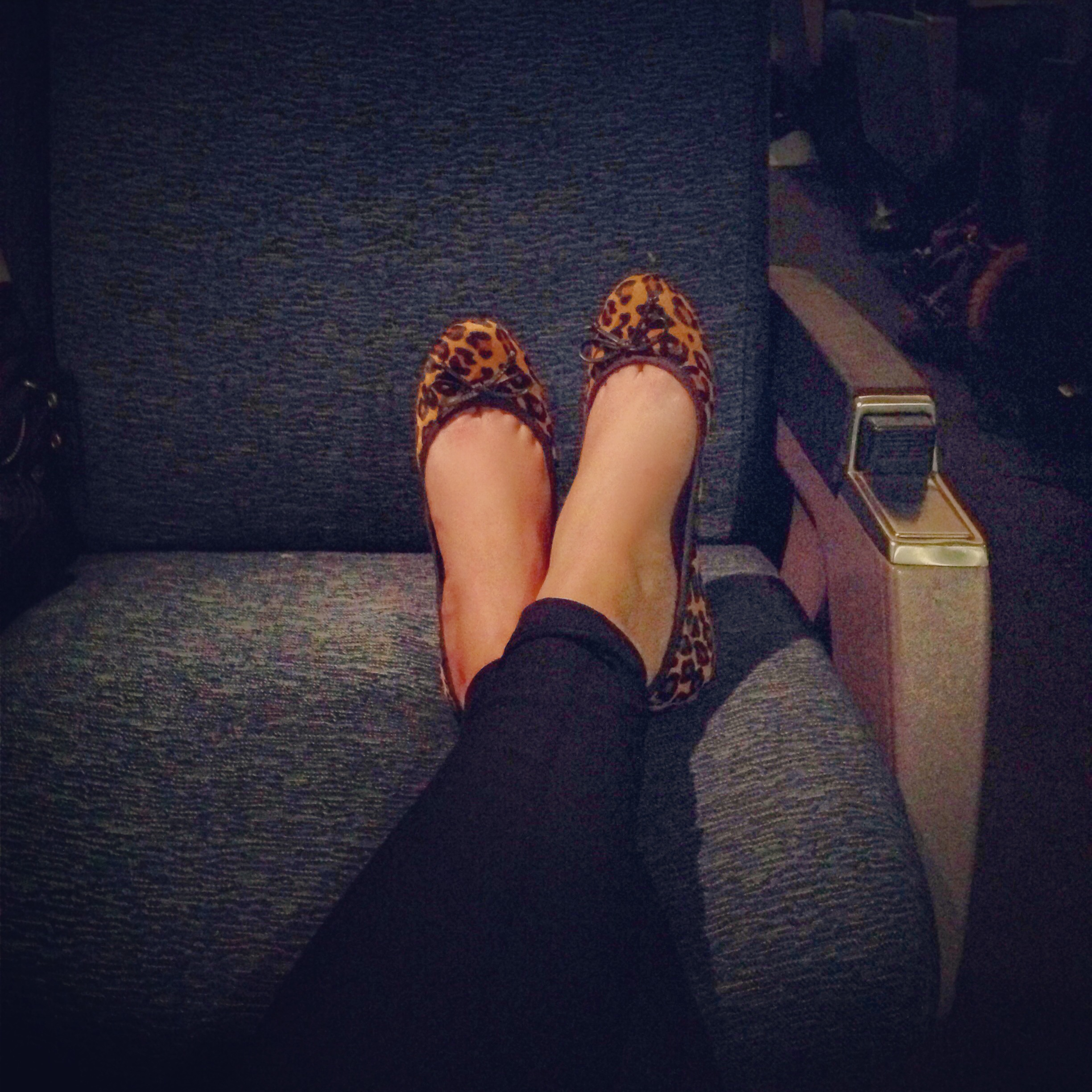 leopard shoes, riding on the train