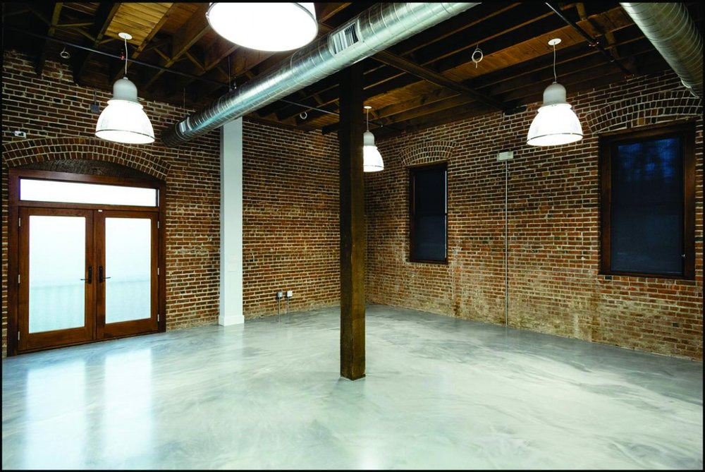 Our Studio - has a spacious 1,200 sq. ft. open floor plan with 14 ft. high ceilings.