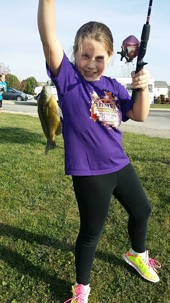 3rd grader Geralyn Christie proudly holds up her catch.