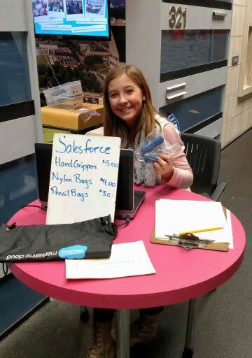 """Noelle Stinnett works her""""Salesforce"""" station."""
