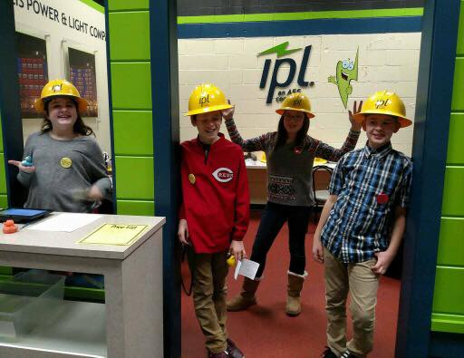 "Posing with hardhats at ""Indianapolis Power and Light."""