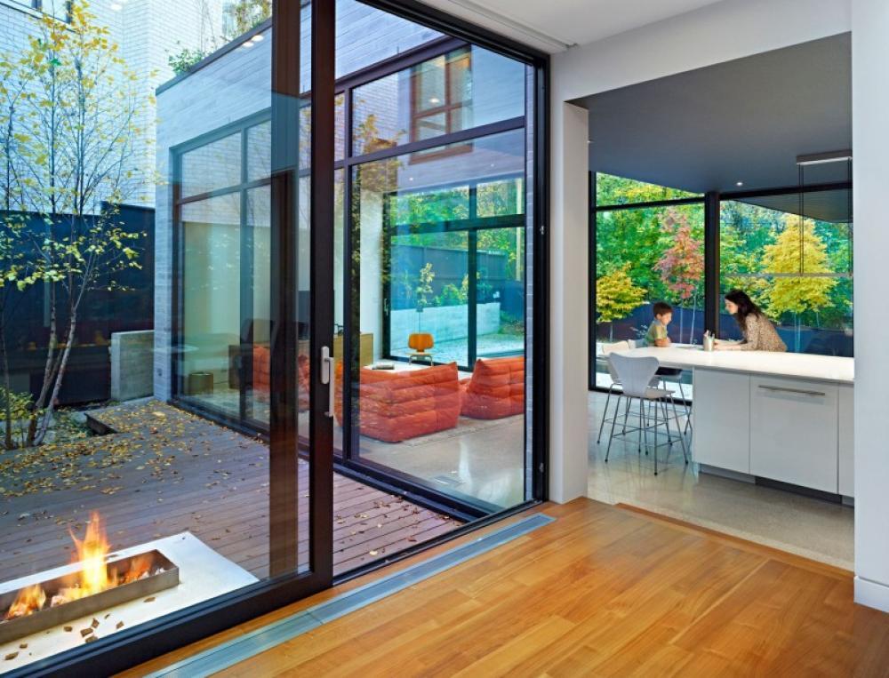 veneer-wood-floor-with-translucent-glass-door-and-wall-with-outdoor-view.jpg
