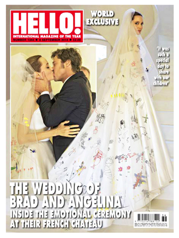 The happy bride affectionately kisses her now-husband Brad Pitt on the cover of  Hello! magazine .