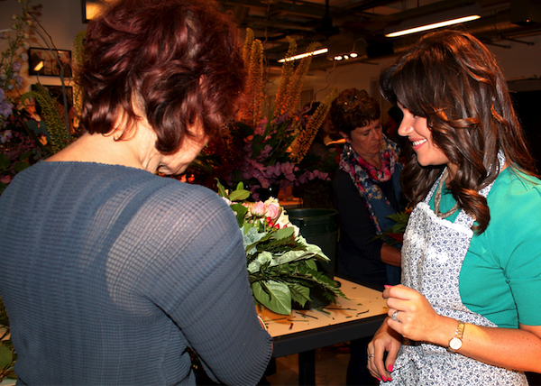 Dawn inspects Liesl's spiral bouquet