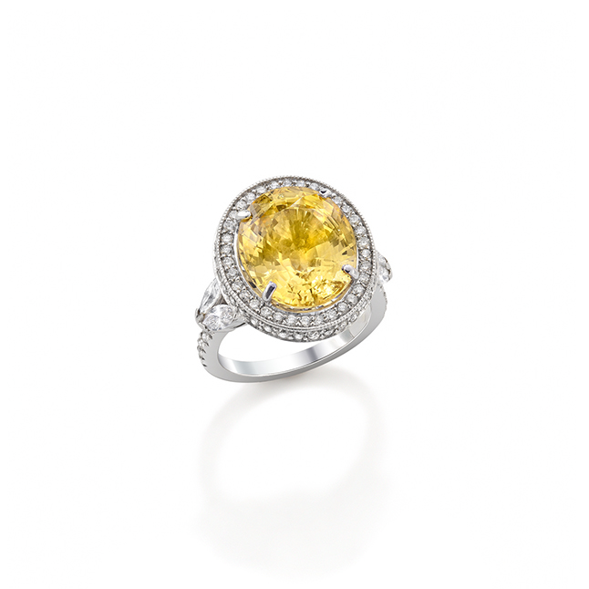 Yellow Sunburst Sapphire Ring. Oval cut yellow Ceylon sapphire surrounded by pave set diamonds.
