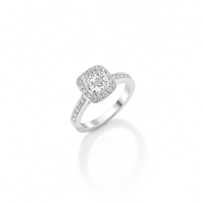 Diamond Cluster Ring. Beautiful cushion cut diamond surrounded by round brilliants set in a pave beading finish in platinum.