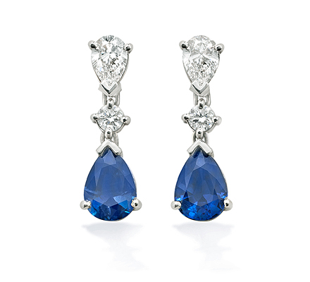 Sapphire Teardrop Earrings. Exquisite deep blue sapphires hanging delicately from round brilliant diamonds with diamond teardrops sitting on top.