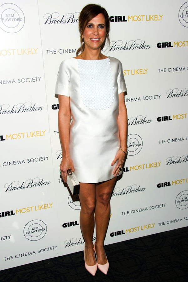 Funny girl Kristen Wiig shows how to work a 60s white shift.