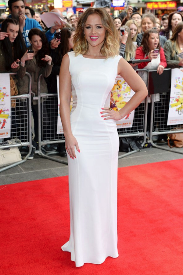 Girls Aloud's Kimberley Walsh wears a sophisticated figure hugging floor length white dress perfectly.