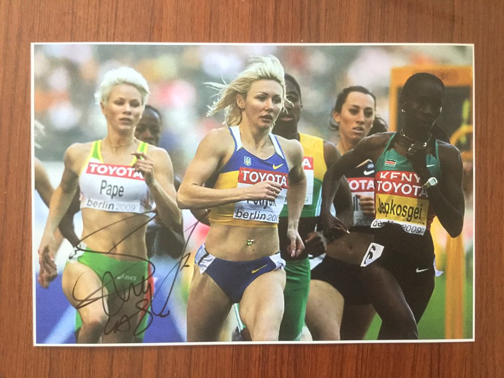 Heats of the women's 800m at the 2009 World Championships, with Caster Semenya's personal autograph (Semenya is mostly concealed, at the center right).