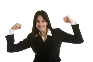 Business woman flexing her muscles to show power, isolated on white background