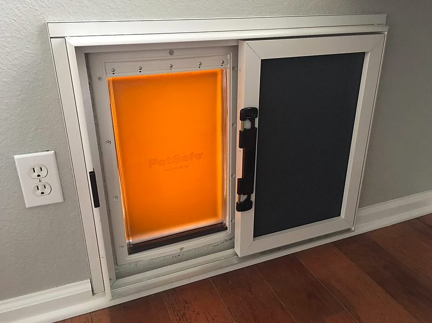 security screen for dog entry door.png