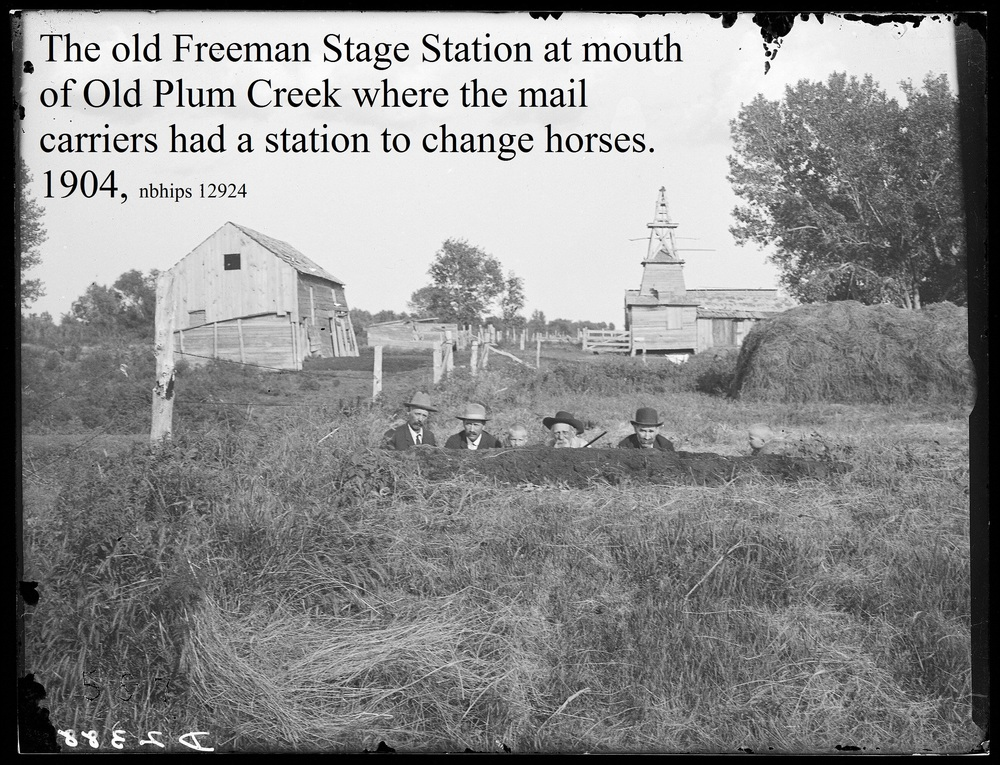 Butcher, Dawson County, Lexington, Stage station Old Plum Creek, 1904 barn & mill with men and kids in a ditch.jpg