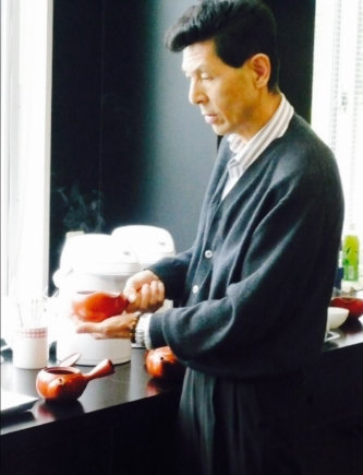 Japanese Tea master in Shizuoka preparing green tea to cup.