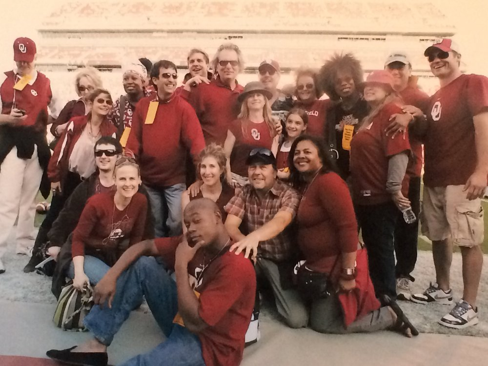 Saving Grace  actors, writers and producers attending an OU football game during a research trip to Oklahoma City (Kristin kneeling in center)