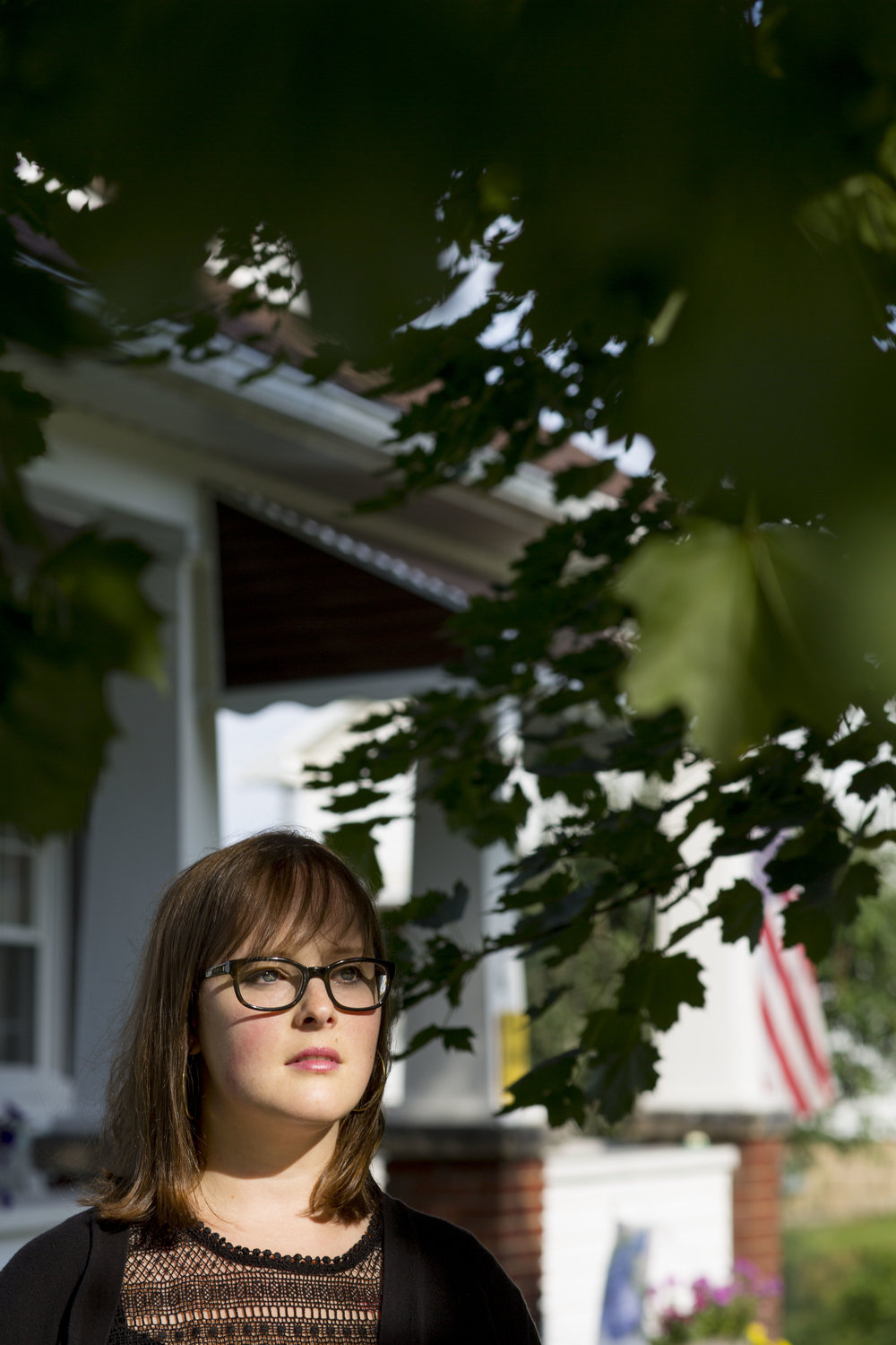 Mina Schultz, 30, stands in front of her mother's home on Wednesday, July 13, 2016 in Rivesville, W.Va. She was diagnosed with a rare form of bone cancer at age 25.