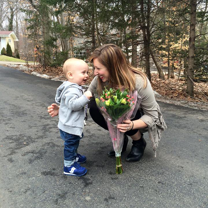 mom and son with flowers
