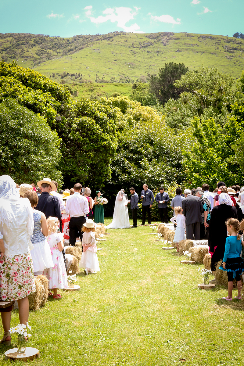 My beautiful ceremony location in my grandma's garden.   Photo by Kim Wheeler Photography